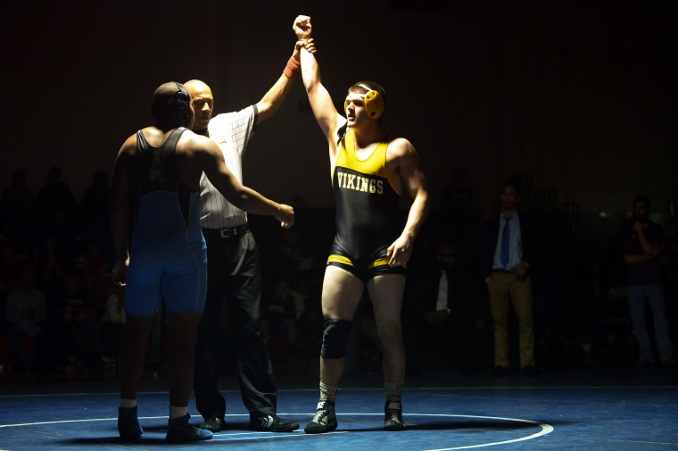 Ryan Hassan, right, of Mt. Hebron celebrates after defeating Necho Freeman, left, of Western Tech at the end of their 220 pound weight bout match at the Franklin Invitational. (Matt Hazlett/BSMG)