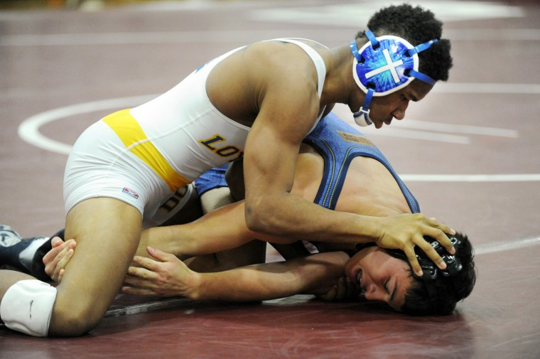 Latin's Anthony Wyler, bottom, loses neutral position and his grip on the leg of Loyola's Walter Johnson in the 152 pound weight class match during a wrestling meet at Boys' Latin School in Baltimore on Wednesday, Jan 15. (Brian Krista/BSMG)
