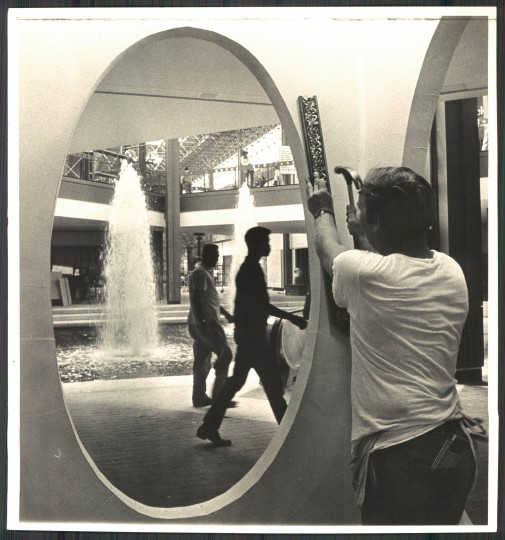 Photo from July 29, 1971 Original caption: Workmen are busy putting final touches on stores in Columbia Mall. (Baltimore Sun Photo/Frank R Gardina)