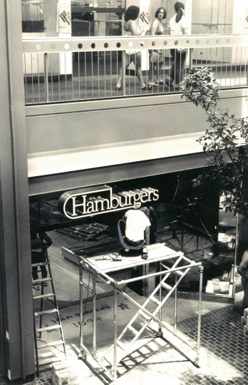 Photo from August 3, 1981 Original caption: A sign for Hamburgers is put up in the new wing of the Columbia Mall. (Baltimore Sun Photo/April Saul)