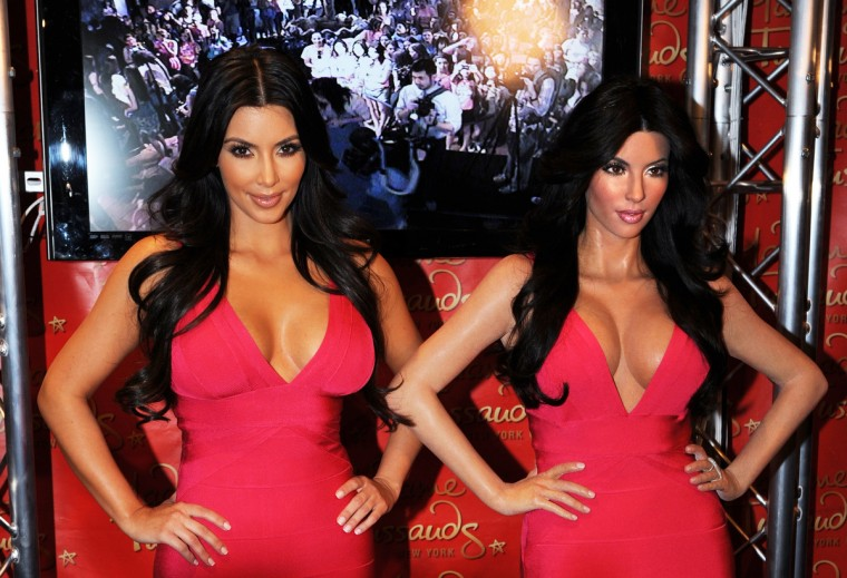 Reality television star Kim Kardashian (L) poses next to her wax figure July 1, 2010 at Madame Tussauds New York. (Stan Honda/Getty Images)