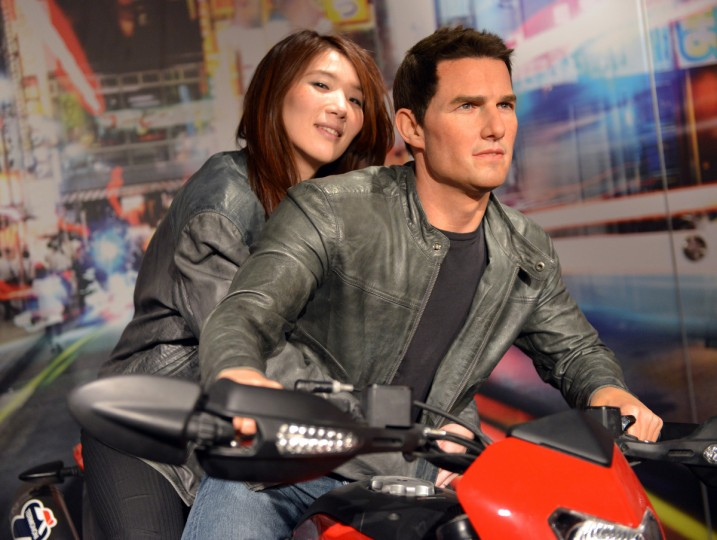 A woman sits on a motorbike with the wax figure of Hollywood star Tom Cruise at a press preview of Madame Tussauds museum in Tokyo on March 13, 2013. Tokyo's Madame Tussauds museum will exhibit some 60 wax figures of Japanese and foreign stars when it re-opens on March 15. (Yoshikazu Tsuno/Getty Images)