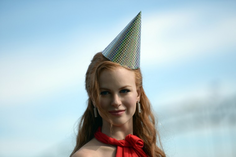A wax figure of Australian actor Nicole Kidman wearing a birthday hat is displayed during a celebration of the first anniversary of Madame Tussauds Sydney in front of the Harbour Bridge and the Opera House in Sydney on April 17, 2013. Madame Tussauds Sydney organised a birthday party with wax figures of Australian celebrities including Nicole Kidman, Keith Urban, Dannii Minogue, Miranda Kerr, Eric Bana and Lleyton Hewitt. (Saeed Khan/Getty Images)