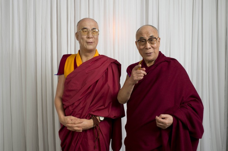 His Holiness the Dalai Lama visits Madame Tussauds and poses with a wax figure of himself, on June 14, 2013 in Sydney, Australia. (Getty Images)