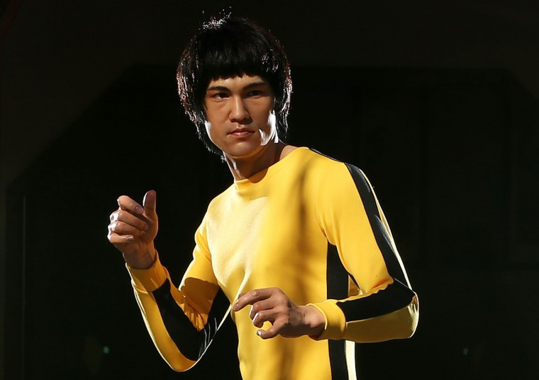 A wax figure of Chinese actor, Bruce Lee is seen at the Chinese Garden of Friendship on August 13, 2013 in Sydney, Australia. The Bruce Lee wax figure will be on display at Madame Tussauds Sydney to mark the 40th anniversary of the actor's death. ( Mark Metcalfe/Getty Images)