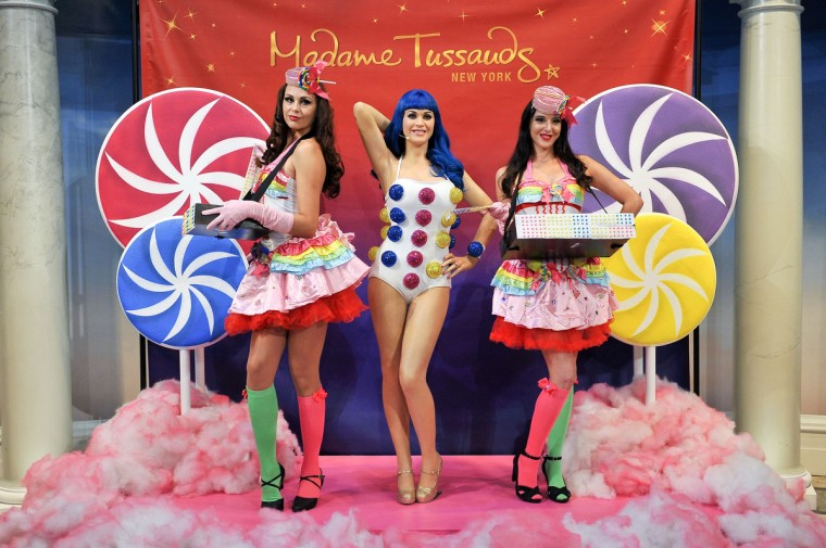 Usherettes pose with a new wax figure of Katy Perry unveiled at Madame Tussauds on September 24, 2013 in New York City. (D Dipasupil/Getty Images)