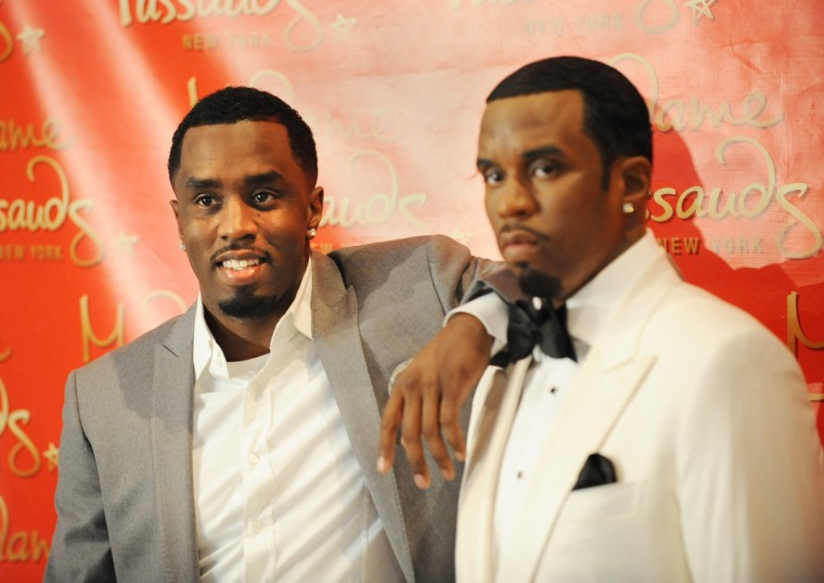 "Sean ""Diddy"" Combs (L) poses with a wax figure in his likeness unveiled December 15, 2009 at Madame Tussauds New York wax museum. (Stan Honda/Getty Images)"