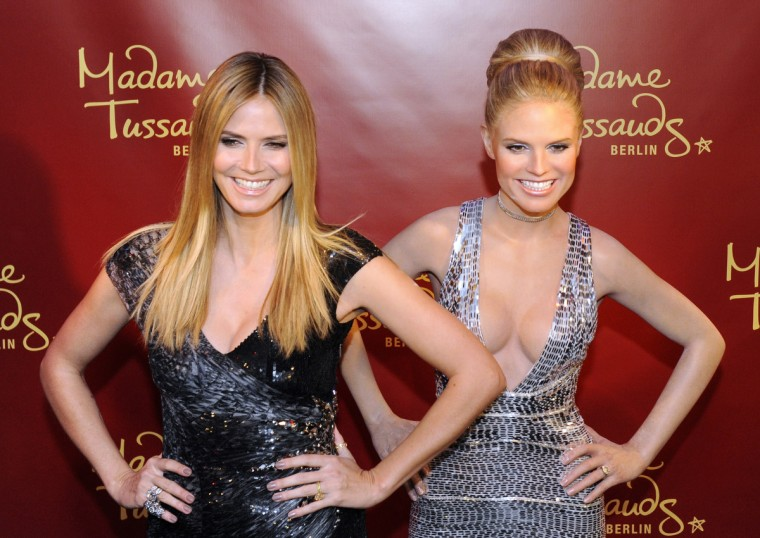 German top model Heidi Klum smiles as she poses with a wax likeness of herself during an unveiling ceremony at Berlin's Madame Tussaud wax museum on January 25, 2010. (Heidi Klum/Getty Images)