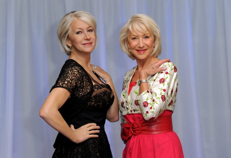 Dame Helen Mirren (R) attends a photocall to unveil a new waxwork of herself at Madame Tussauds on May 11, 2010 in London, England. ( Gareth Cattermole/Getty Images)