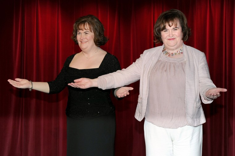 Susan Boyle poses for photos alongside her new wax figure at the official launch of the new Madame Tussauds venue in Blackpool on April 19, 2011 in Blackpool, England. (Shirlaine Forrest/Getty Images)