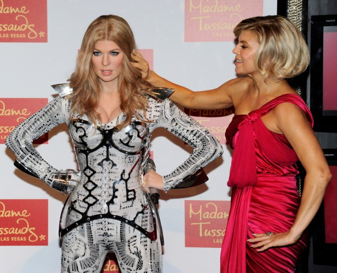 "Singer Stacy ""Fergie"" Ferguson of the Black Eyed Peas touches the hair of her wax figure after it was unveiled at Madame Tussauds Las Vegas at The Venetian September 22, 2011 in Las Vegas, Nevada. (Ethan Miller/Getty Images)"