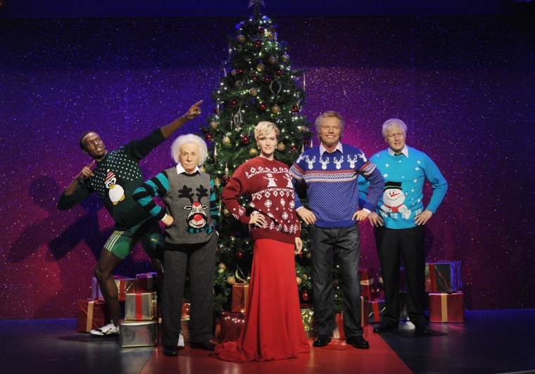 Waxworks of Usain Bolt, Albert Einstein, Kate Winslet, Richard Branson and Boris Johnson are dressed in Christmas jumpers in support of the Save The Children campaign at Madame Tussauds on December 3, 2013 in London, England. ( Stuart C. Wilson/Getty Images)