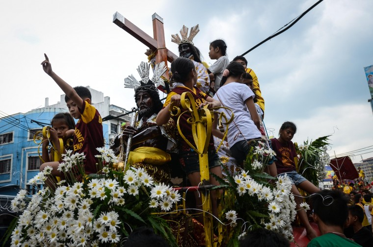 Thousands of Catholic devotees of the Black Nazarene converge in the streets of Manila on January 7, 2014 in Quiapo district, Manila, Philippines. The Feast of the Black Nazarene culminates in a day long procession on January 9 as barefoot devotees march to see and touch the image of the Black Nazarene. The Black Nazarene is a dark wood sculpture of Jesus brought to the Philippines in 1606 from Spain and considered miraculous by Filipino devotees. As many as 6 million devotees are expected to attend during the culmination in this predominantly Catholic nation in Southeast Asia. (Dondi Tawatao/Getty Images)