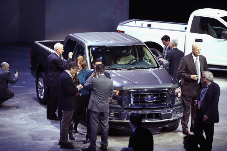 Members of the media look over the Ford F-150 pickup truck after its introduction at the North American International Auto Show on January 13, 2014 in Detroit, Michigan. (Scott Olson/Getty Images)