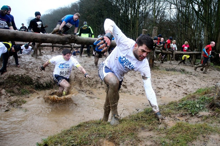 Participants make their way through water during the Tough Guy Challenge on January 26, 2014 in Telford, England. (Ben Hoskins/Getty Images)