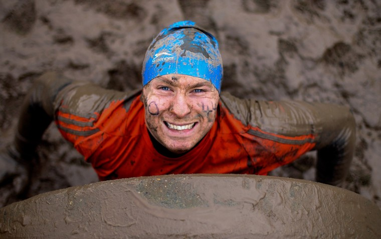 A participant pulls himself from a tunnel during the Tough Guy Challenge on January 26, 2014 in Telford, England. (Ben Hoskins/Getty Images)