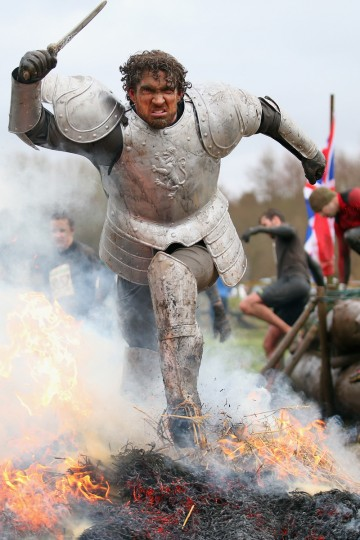 A competitor dressed as a knight runs through a fire during the Tough Guy Challenge on January 26, 2014 in Telford, England. (Bryn Lennon/Getty Images)