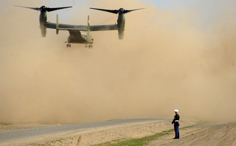 A U.S. Marine watches as an Osprey helicopter lands on February 14, 2014 in Los Banos, California. Obama met with farmers and ranchers while pledging millions of dollars in federal funds for drought relief projects in California. (Wally Skalij/Getty Images)