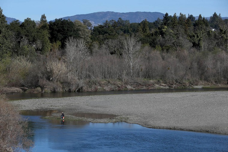 A man fishes from the banks of the Russian River near Healdsburg Veterans Memorial Beach Park on February 21, 2014 in Healdsburg, California. Sonoma County breweries Lagunitas and Bear Republic rely on water from the Russian River and are worried that the extremely low water levels in the 110-mile waterway will force them to seek water from other sources, including well water, which could have an impact on the taste of their beers. (Justin Sullivan/Getty Images)