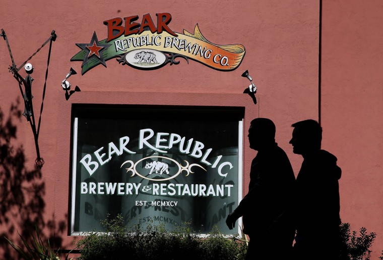 Pedestrians walk by the Bear Republic Brewery and Restaurant on February 21, 2014 in Healdsburg, California. Sonoma County breweries Lagunitas and Bear Republic rely on water from the Russian River and are worried that the extremely low water levels in the 110-mile waterway will force them to seek water from other sources, including well water, which could have an impact on the taste of their beers. (Justin Sullivan/Getty Images)