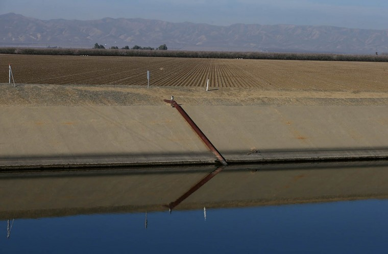 The San Luis Canal flows by an unplanted field on February 25, 2014 in Firebaugh, California. As the California drought continues and farmers struggle to water their crops, the U.S. Bureau of Reclamation officials announced this past Friday that they will not be providing Central Valley farmers with any water from the federally run system of reservoirs and canals fed by mountain runoff. (Justin Sullivan/Getty Images)