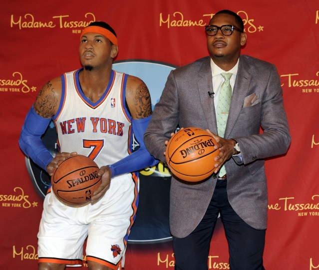 New York Knicks star Carmelo Anthony poses next to his wax likeness at the unveiling at Madame Tussauds New York June 26, 2012. Anthony was an active participant in the creation process as well and spent more than three hours with a team of Madame Tussauds studio artists who took hundreds of precise measurements and photos to ensure the accuracy of his wax figure – including the meticulous recreation of Anthony's signature tattoos. (Timothy A. Clary/Getty Images)