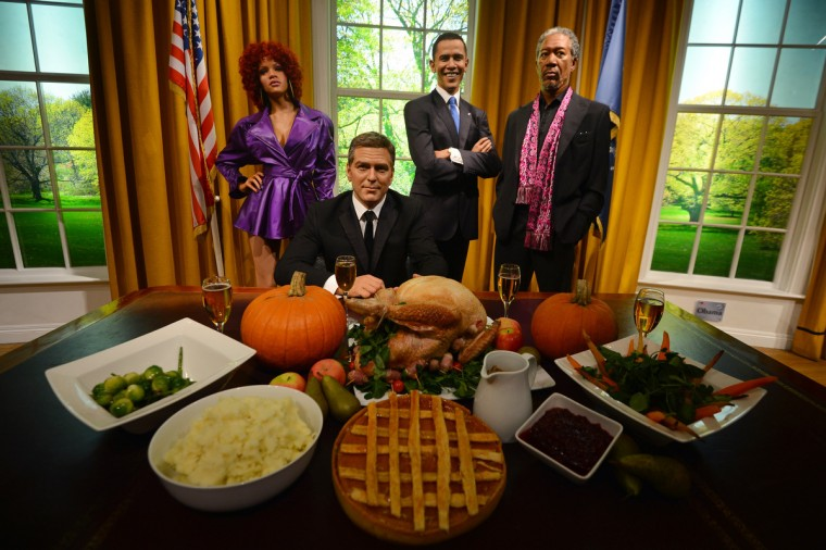 Wax figures of US musician Rihanna (L), actors George Clooney (2nd L) and Morgan Freeman (R) join US President Barack Obama (2nd R) in a recreation of the Oval Office for Thanksgiving at Madame Tussauds in London on November 21, 2012. (Ben Stansall/Getty Images)