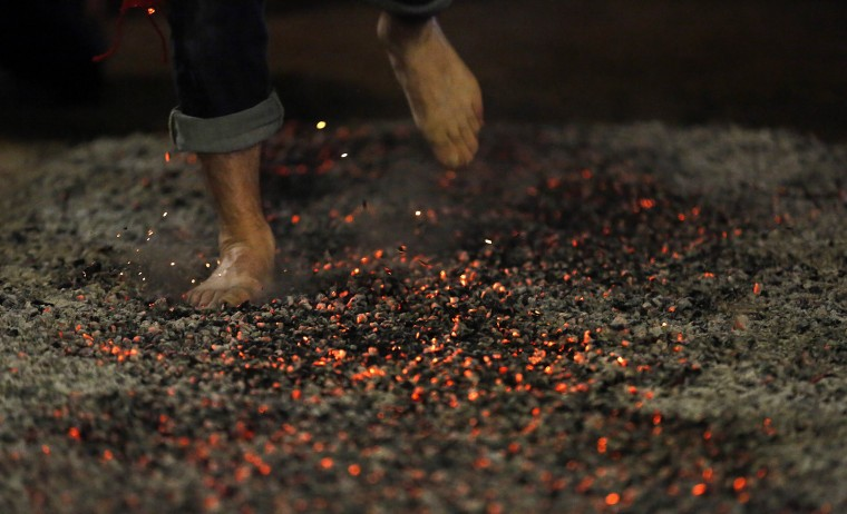 Hot coals in Spain: A reveler rushes through burning embers during the night of San Juan in San Pedro Manrique, Soria province in northern Spain early on June 24, 2013. The ritual consists in starting a bonfire and for the locals to step barefoot on hot coals without burning the soles of their feet, and most times with someone on their back. ( CESAR MANS | AFP/Getty Images )