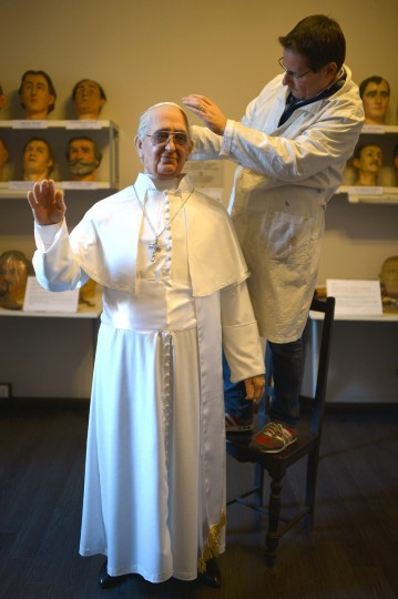 Fernando Canini, director of Rome's wax museum, gives the final touch at the new wax statue representing Pope Francis, on December 5, 2013 in Rome. (Gabriel Bouys/Getty Images)