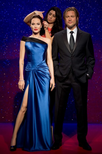 Hair stylist Caryn Bloom poses for photographers as new wax figures of US actors Angelina Jolie and Brad Pitt are unveiled at Madame Tussauds in central London. (Leon Neal/Getty Images)