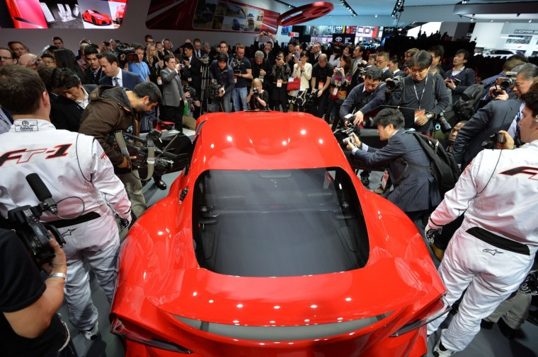 Members of the media get a look at the Toyota FT-1 concept car during a press preview at the North American International Auto Show January 13, 2014 in Detroit, Michigan. (Stan Honda/Getty Images)