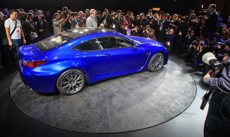 Journalists surround the 2015 Lexus RCF seen at the 2014 North American International Auto Show in Detroit, Michigan. (Geoff Robins/AFP/Getty Images)
