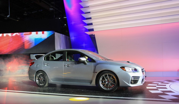 The new Subaru WRX STi is introduced at the 2014 North American International Auto Show in Detroit, Michigan. (Geoff Robins/Getty Images)
