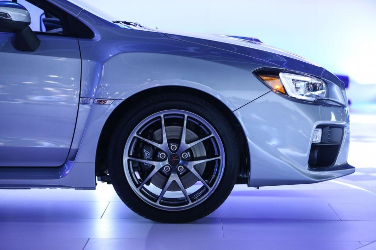 The new Subaru WRX STi is introduced at the 2014 North American International Auto Show in Detroit, Michigan. (Geoff Robins/AFP/Getty Images)