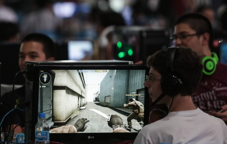 Participants in the Campus Party Brazil, a technological event , in Anhembi, northern zone of Sao Paulo, Brazil, check out some technology. (Miguel Schincariol/Getty Images)