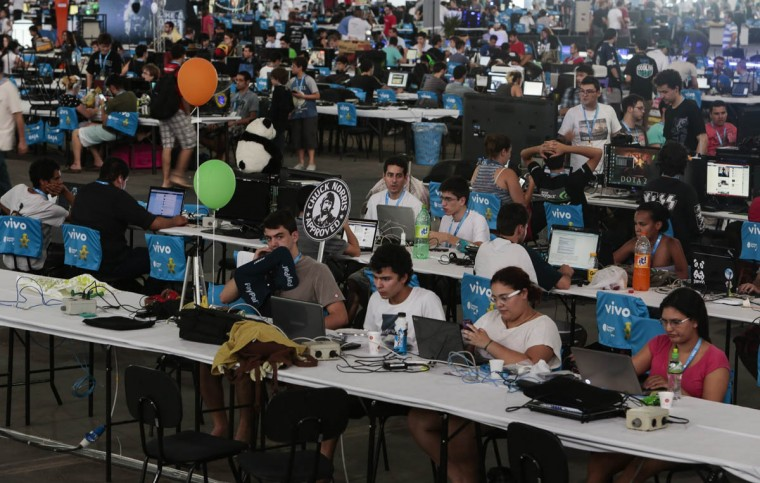 Many participants in the Campus Party Brazil, a technological event, look at computers, games, and other technology. (Miguel Schincariol/Getty Images)