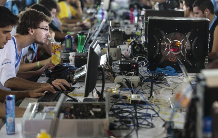A young man takes part in the technological event Campus Party Brazil. (Miguel Schincariol/Getty Images)