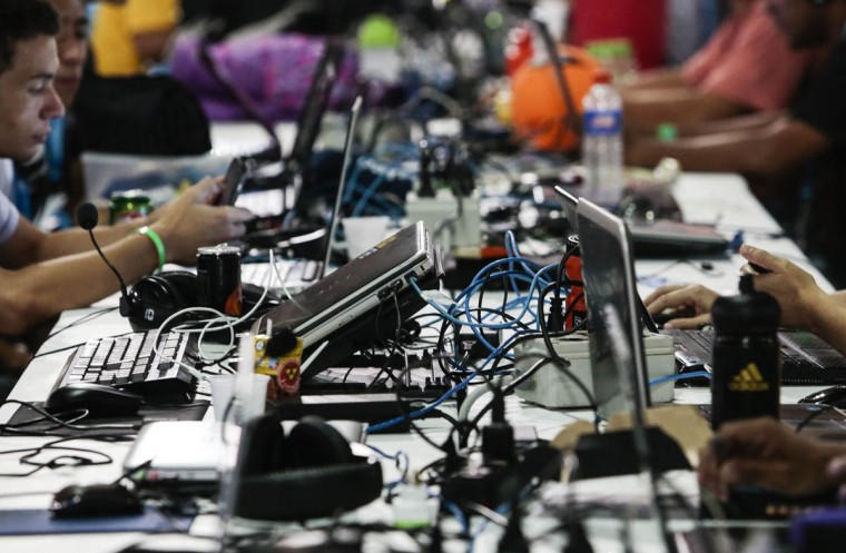 A young man takes part in the technological event Campus Party Brazil. About 160,000 visitors are expected to attend the event that runs from January 27 to February 2. ( Miguel Schincariol/Getty Images)