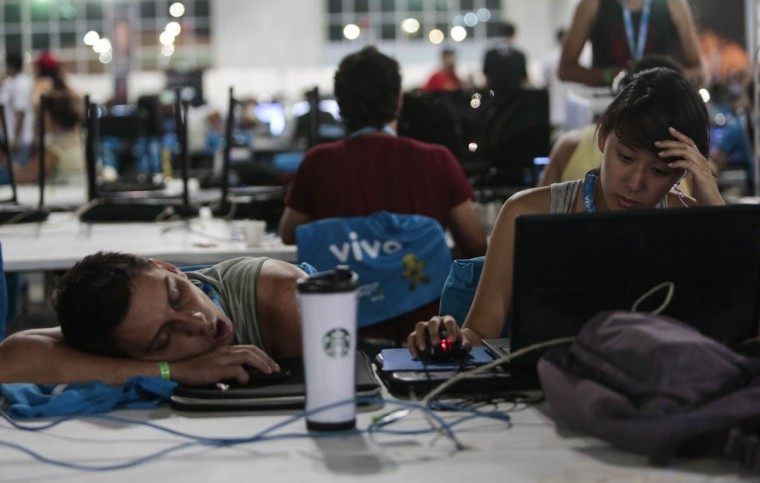 Young people take part in the technological event Campus Party Brazil. (Miguel Schincariol/Getty Images)