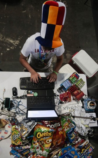 A young man takes part in the technological event Campus Party Brazil, in Anhembi, northern Sao Paulo, Brazil. (Miguel Schincariol/Getty Images)