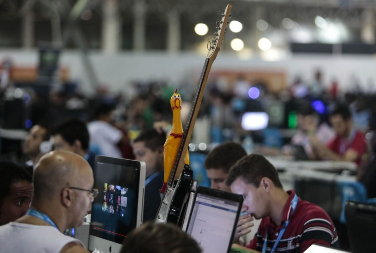 A rubber chicken and guitar sit amidst the technology at Campus Party Brazil. (Miguel Schincariol/Getty Images)