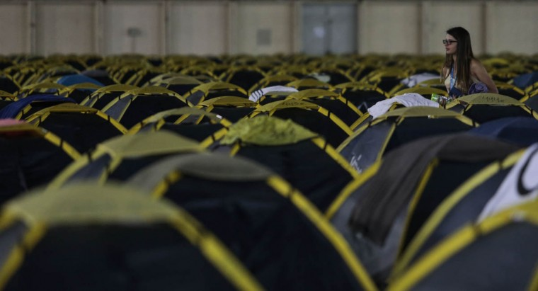 A participant of the technological event Campus Party Brazil is seen amid the hundreds of tents set up for them at the convention centre. (Miguel Schincariol/Getty Images)