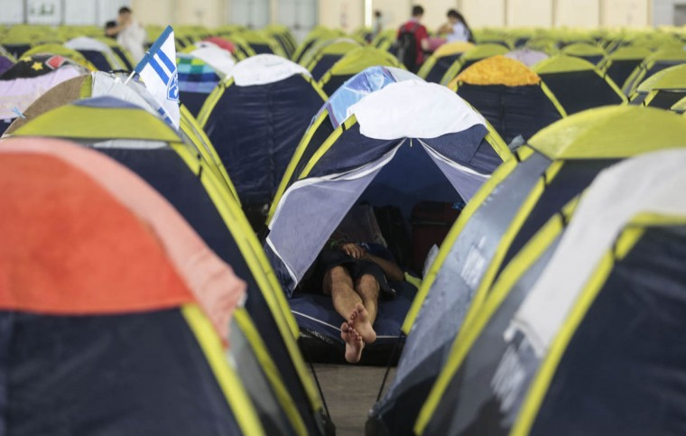 A participant of the technological event Campus Party Brazil remains in one of hundreds of tents set up for them at the convention centre in Anhembi, northern Sao Paulo, Brazil, About 160,000 visitors are expected to attend the event that runs from January 27 to February 2. (Miguel Schincariol/Getty Images)