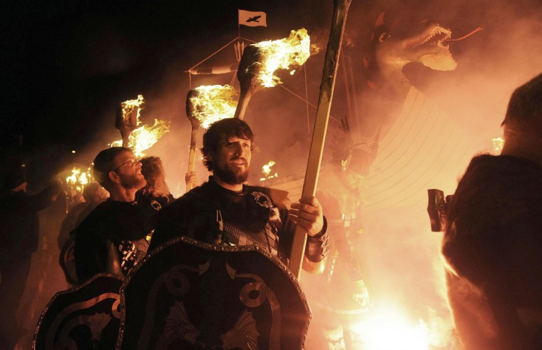 Participants dressed as Vikings carry burning brands as they take part in the annual Up Helly Aa festival in Lerwick, Shetland Islands, on January 28, 2014. Up Helly Aa celebrates the influence of the Scandinavian Vikings in the Shetland Islands and culminates with up to 1,000 'guizers' (men in costume) throwing flaming torches into their Viking longboat and setting it alight later in the evening. (Andy Buchanan/Getty Images)