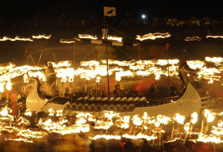 Participants dressed as Vikings process around their longboat during the annual Up Helly Aa festival in Lerwick, Shetland Islands, on January 28, 2014. Up Helly Aa celebrates the influence of the Scandinavian Vikings in the Shetland Islands and culminates with up to 1,000 'guizers' (men in costume) throwing flaming torches into their Viking longboat and setting it alight later in the evening. (Andy Buchanan/Getty Images)