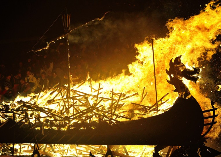 The Viking longboat burns during the annual Up Helly Aa festival in Lerwick, Shetland Islands, on January 28, 2014. Up Helly Aa celebrates the influence of the Scandinavian Vikings in the Shetland Islands and culminates with up to 1,000 'guizers' (men in costume) throwing flaming torches into their Viking longboat and setting it alight later in the evening. (Andy Buchanan/Getty Images)