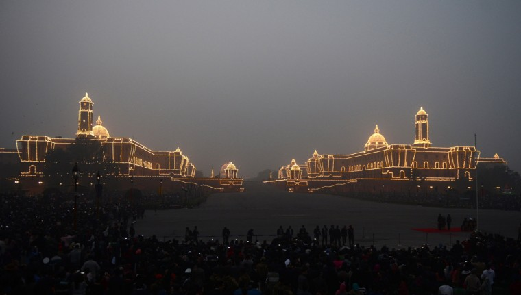 The Central Secretariat and Parliament buildings are illuminated during the Beating Retreat Ceremony at Vijay Chowk in New Delhi on January 29, 2014. The ceremony is a culmination of Republic Day celebrations and dates back to the days when troops disengaged themselves from battle at sunset. (Raveendran/Getty Images)