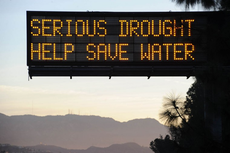 A sign over a highway in Glendale, California warns motorists to save water in response to the state's severe drought, February 14, 2014. US President Barack Obama is visiting drought-stricken California today and is expected to announce more than $160 million in federal financial aid to help California recover from the crippling drought that is threatening the state's agriculture industry. (Robyn Beck/Getty Images)