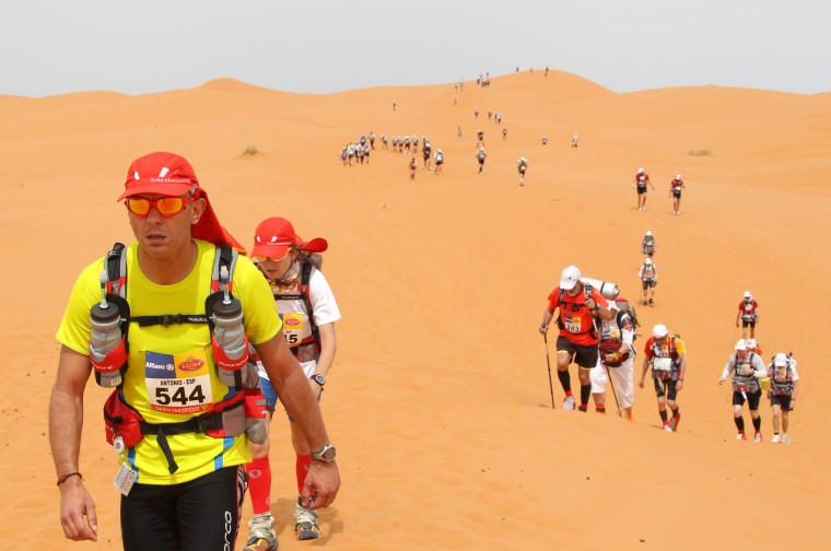 """Marathon des Sables: A competitor runs on a dune, on April 10, 2013, during the 28th edition of the """"Marathon des Sables,"""" some 300 kilometers south of Ouarzazate. The 223,8 kms Desert Marathon is considered as one of the hardest in the world. About 1024 participants, from 45 nationalities and aged 20 to 76, have to walk during seven days in the Moroccan Sahara and carry all their equipment and food on their backs. (PIERRE VERDY/AFP/Getty Images)"""