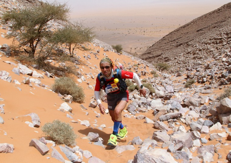 """A competitor climbs a stony steep-sided gorge in jebel Foum Al Hopaht during the third stage of the 26th edition of the """"Marathon des Sables"""" (Sand Marathon) on April 5, 2011. (PIERRE VERDY/AFP/Getty Images)"""